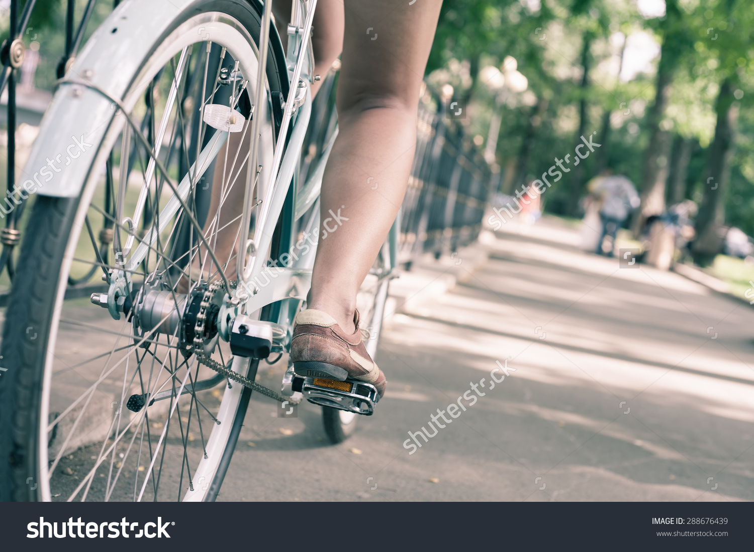 stock-photo-closeup-woman-riding-by-blue-vintage-city-bicycle-at-the-city-center-it-is-like-concept-for-288676439